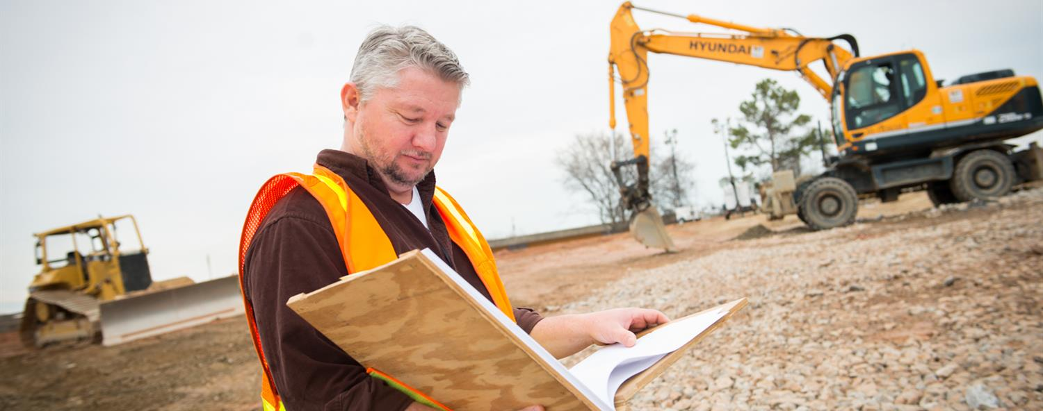 Construction superintendant holding blueprints